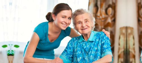 smiling old woman and young woman