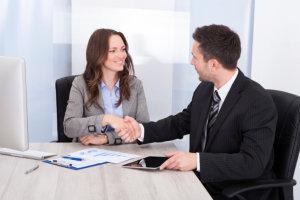 business man and woman doing shake hand